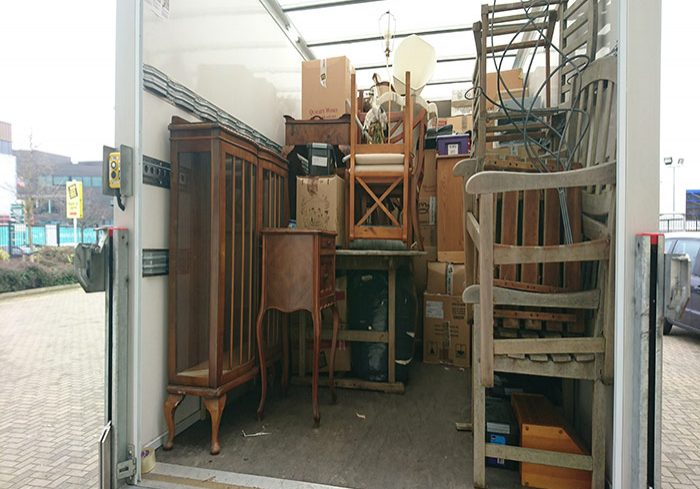 furniture stacked in a removal van